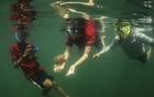 """Visitors swim with stingless jellyfish on Kakaban Lake on Kakaban Island in Indonesia, Oct 12, 2019. For divers, the millions of harmless jellyfish in an Indonesian lake are must-see novelties. For scientists, the warmer, more acidic and less oxygenated water is """"a projection of our future climate."""" The New York Times"""