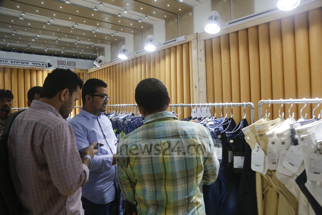 Visitors crowd a stall on the first day of the Bangladesh Denim Expo at the International Convention City Bashundhara in Dhaka on Tuesday. Photo: Mahmud Zaman Ovi