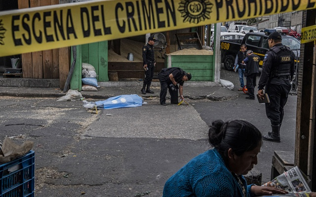 FILE PHOTO: A murder scene in a market in Guatemala City on Oct 4, 2018. Poor Guatemalans, desperate to come to the United States, take out loans under false pretence to finance their journey but the dream is often elusive. The New York Times