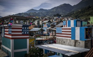 US flags are painted on more than a dozen tombs in the cemetery of Todos Santos Cuchumatán, Guatemala, signalling that the money to build the structures came from the United States, on Aug 25, 2018. The New York Times