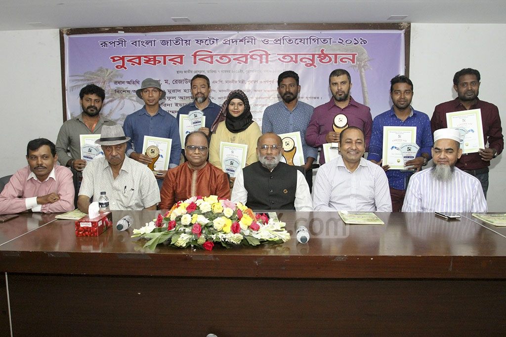 The winners of 'Ruposhi Bangla National Photo Exhibition and Competition 2019 organised by Bangladesh Photo Journalist Association pose with their awards.