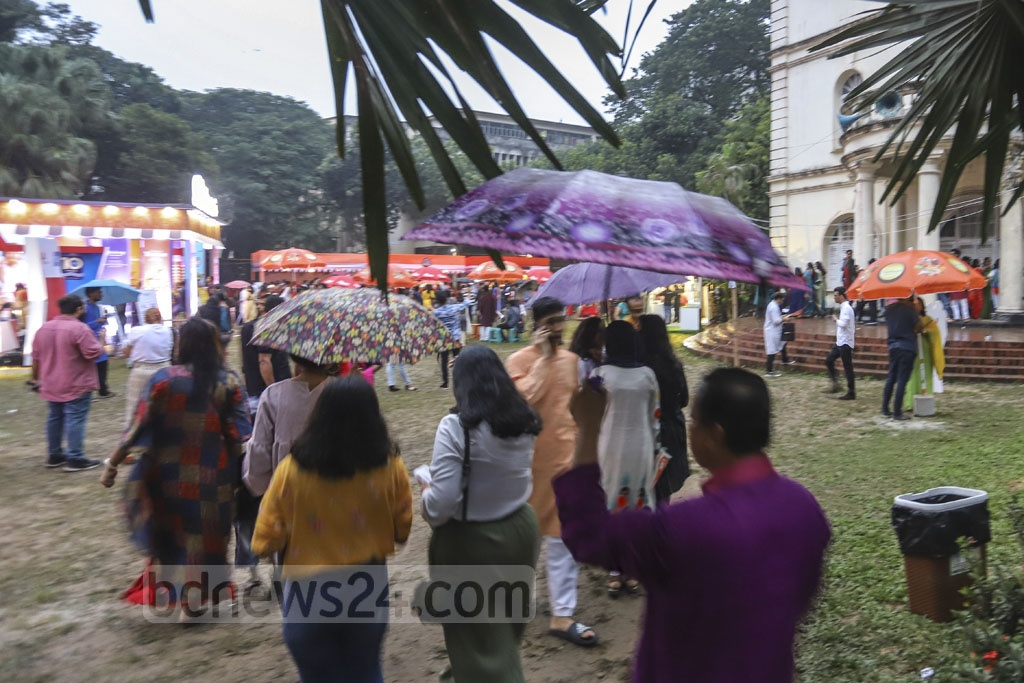 People carrying umbrellas at a programme at the Bangla Academy in Dhaka on Friday as a cyclone over the Bay of Bengal triggers rains in different parts of the country. Photo: Asif Mahmud Ove