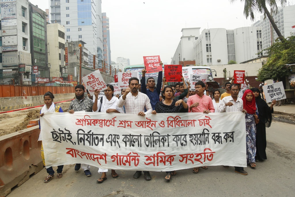 Activists of various rights groups demand an end to job cuts and abuse faced by garment workers in front of the National Press Club on Friday. Photo: Mahmud Zaman Ovi