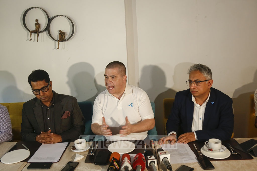 Grameenphone Chief Executive Officer Michael Foley, Chief Marketing Officer Yasir Azman and Head of Regulatory Affairs Hossain Sadat speak to reporters at a hotel in Dhaka on Monday. Photo: Mahmud Zaman Ovi