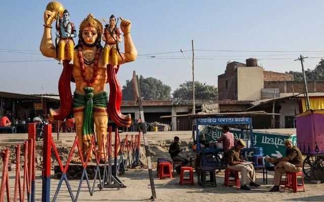 A statue of Hindu monkey god Hanuman is seen next to security barricade as police officers take a break after Supreme Court's verdict on a disputed religious site, in Ayodhya, India, Nov 11, 2019. REUTERS