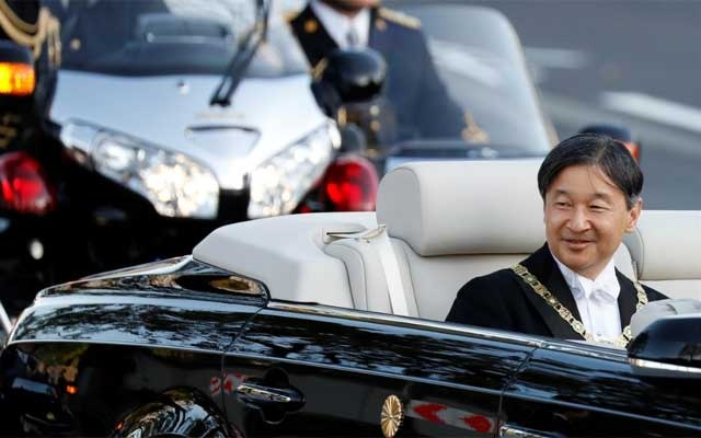 Japan's Emperor Naruhito rides in a car during the royal parade to mark the enthronement of Japanese Emperor Naruhito in Tokyo, Japan, Nov 10, 2019. REUTERS