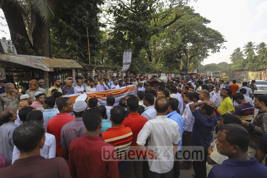 Water transport workers demonstrate in front of the National Press Club in Dhaka on Tuesday to press home their 11-point charter of demands.