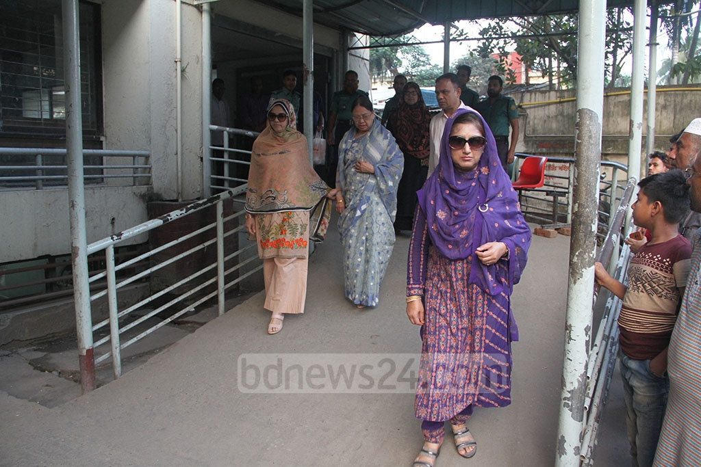Khaleda Zia's sister Selima Islam and her family members emerging from the Bangabandhu Sheikh Mujib Medical University Hospital or BSMMU after visiting the BNP chief on Wednesday.