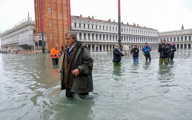 The Mayor of Venice Luigi Brugnaro walks on St Mark's Square during an exceptionally high water levels in Venice, Italy November 13, 2019. Reuters