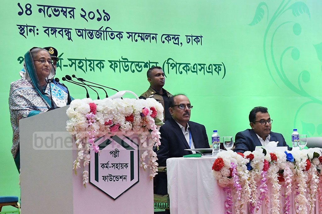 Prime Minister Sheikh Hasina speaks at the inaugural session of a development fair organised by Palli Karma-Sahayak Foundation at the Bangabandhu International Conference Centre on Thursday.