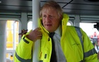 Britain's Prime Minister Boris Johnson leans on a pole in the steering cabin of a tugboat during a general election campaign stop in the port of Bristol, Britain November 14, 2019. Frank Augstein/Pool via REUTERS
