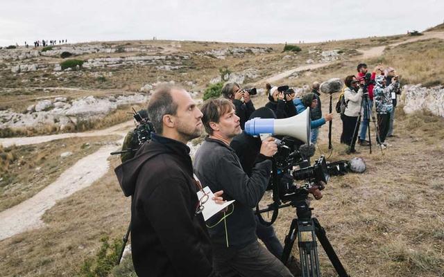 "Milo Rau, with bullhorn, directs during the crucifixion scene for ""The New Gospel,"