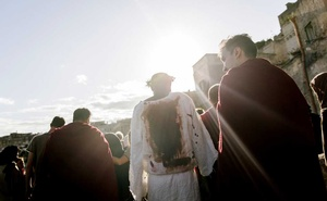 """Yvan Sagnet, portraying Christ, and other actors during a day of filming for """"The New Gospel,"""