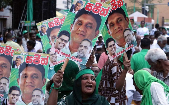 Supporters of the Sajith Premadasa, Sri Lanka's presidential candidate of the ruling United National Party (UNP) led New Democratic Front alliance cheer at the final election campaign rally, in Colombo, Sri Lanka November 13, 2019. Picture taken November 13, 2019. REUTERS