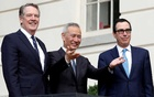 FILE PHOTO: China's Vice Premier Liu He gestures to the media between US Trade Representative Robert Lighthizer (L) and Treasury Secretary Steve Mnuchin before the two countries' trade negotiations in Washington, US, Oct10, 2019. REUTERS