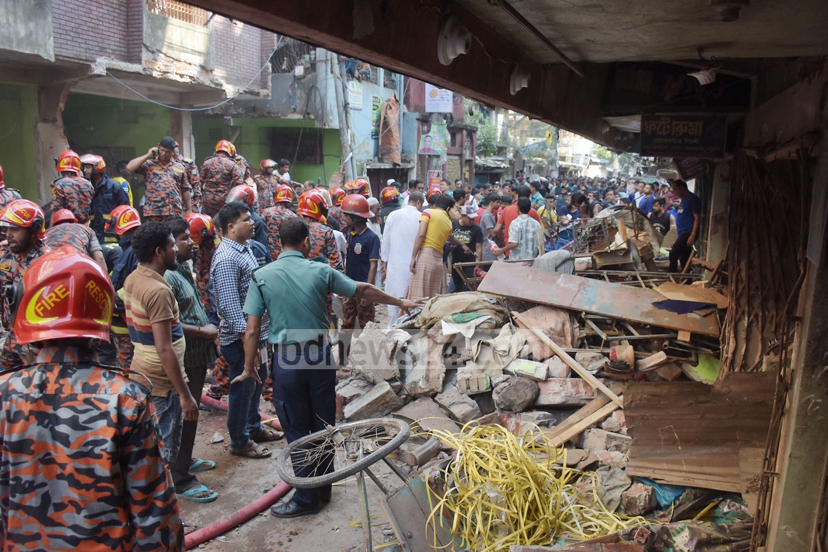 A rickshaw overturned after being hit by a gas pipeline explosion that took place on the ground floor of a building in Patharghata Brick Field Road in Chattogram on Sunday, leaving at least seven people dead. Photo: Suman Babu
