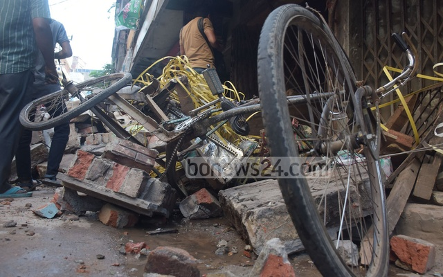 A three-wheeler vehicle became mangled metal after being hit by a gas pipeline explosion that took place in a building in Patharghata Brick Field Road in Chattogram on Sunday, leaving at least seven people dead. Photo: Suman Babu