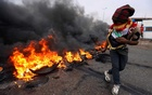 FILE PHOTO: Iraqi protesters burn tires during the ongoing anti-government protests in Basra, Iraq November 17, 2019. REUTERS