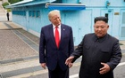FILE PHOTO: U.S. President Donald Trump meets with North Korean leader Kim Jong Un at the demilitarized zone separating the two Koreas, in Panmunjom, South Korea, June 30, 2019. REUTERS