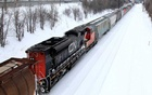 FILE PHOTO: A Canadian National Railway train travels eastward on a track in Montreal, Feb 22, 2015. REUTERS