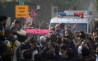 Supporters of Pakistan Muslim League-Nawaz (PML-N) sprinkle rose petals on a car carrying Former Prime Minister Nawaz Sharif, as he makes his way to the airport to travel for a medical treatment in the United Kingdom, outside his residence in Raiwind, near Lahore, Pakistan Nov 19, 2019. REUTERS