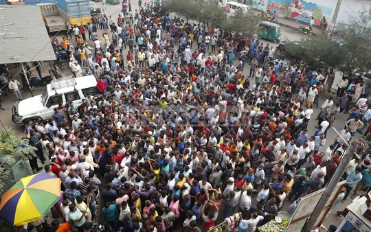 Truckers and lorry owners and workers demonstrate in Dhaka's Tejgaon area on Tuesday, demanding an amendment to the Road Transport Act, passed in 2018.