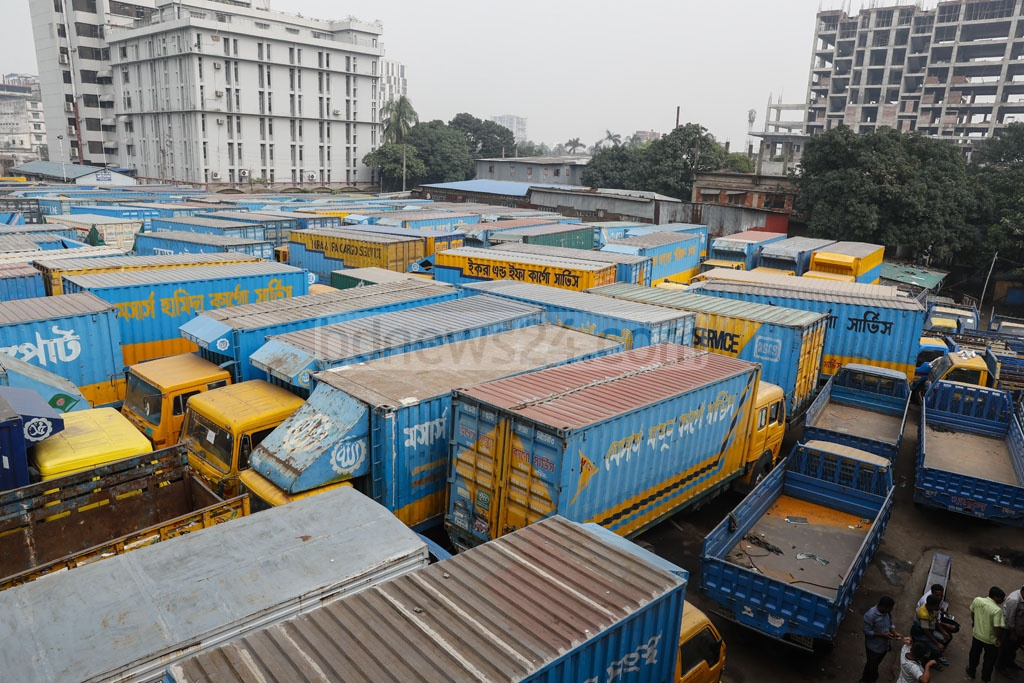 Transport workers pull out of work at a truck terminal in Dhaka's Tejgaon as they protest the new Road Transport Act.