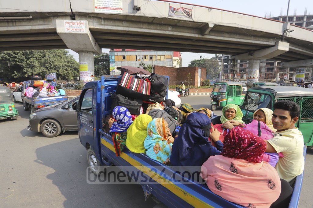 Some commuters hired pickup vans to reach their destinations as public transports were sparse on the roads on Wednesday due to the strike called by transport workers demanding revision of the road transport law. Photo: Asif Mahmud Ove