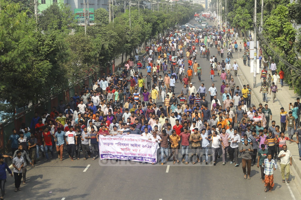 Owners and drivers of trucks and lorries demonstrate in Dhaka's Tejgaon on Wednesday demanding amendments to the new Road Transport Act. Photo: Asif Mahmud Ove