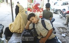 A child fell asleep while waiting for a bus at Gabtoli bus terminal in Dhaka on Thursday. Photo: Asif Mahmud Ove