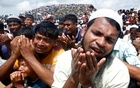 FILE PHOTO: Rohingya refugees pray at a gathering mark the second anniversary of their exodus from Myanmar, at the Kutupalong camp in Cox's Bazar, Bangladesh, Aug 25, 2019. REUTERS