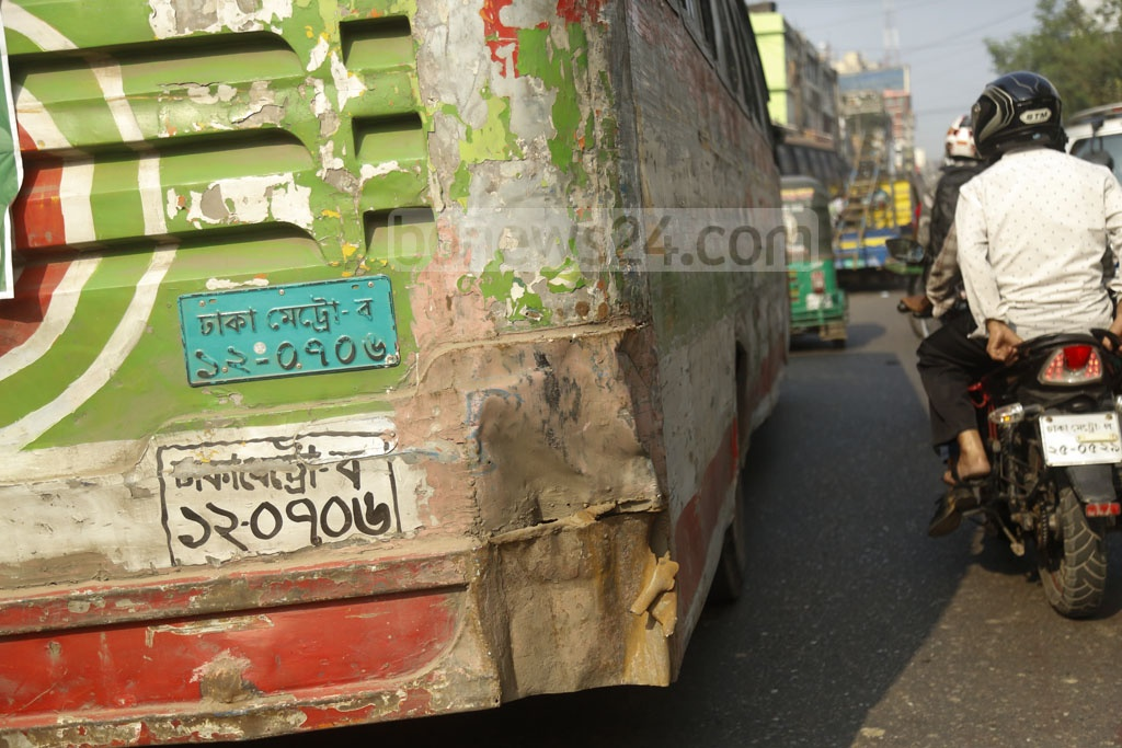 A bus with parts of its back missing is seen on DIT Road in Dhaka on Friday as run-down vehicles continue to ply the streets of the capital despite provisions of huge fines in the new Road Transport Act. Photo: Mahmud Zaman Ovi