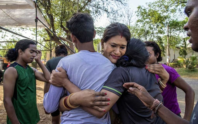"""FILE -- Vidhya Rajput, a transgender activist, hugs transgender participants, who completed a physical test for police service, in Raipur, India, May 5, 2018. """"Everybody wants to live with dignity,"""" said Rajput, who has emerged as a leader in a gathering rights revolution in India. (Atul Loke/The New York Times)"""