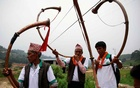 FILE PHOTO: Villagers play traditional musical instruments during an event celebrating National Paddy Day, also called Asar Pandra, that marks the commencement of rice crop planting in paddy fields as monsoon season arrives, in Dhading, Nepal, June 30, 2019. Reuters
