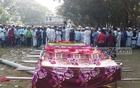 The bodies of nine people who died after a collision between a bus and a microbus in Munshiganj's Sreenagar Upazila, were buried after a namaz-e-janaza in the district's Louhajang Upazila on Saturday.