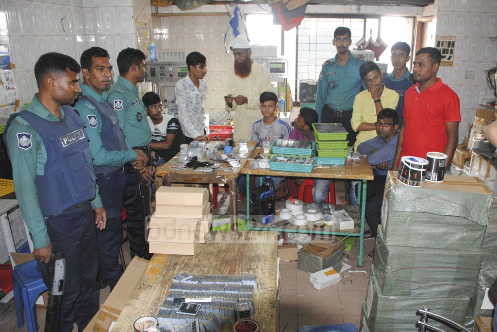 Dhaka Metropolitan Police conducted a mobile court drive on a factory of counterfeit mobile phone battery and spare parts on the eighth floor of Gulistan Hall Market in Dhaka on Monday.