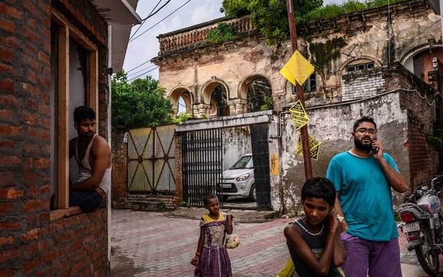 Outside the old Nawab's Palace in Luknow, where Prince Cyrus of Oudh once lived with his mother and sister, in India, Aug. 24, 2019. For 40 years, journalists chronicled the eccentric royal family of Oudh, deposed aristocrats who lived in a ruined palace in the Indian capital — a tragic, astonishing story, but was it true? (Bryan Denton/The New York Times)