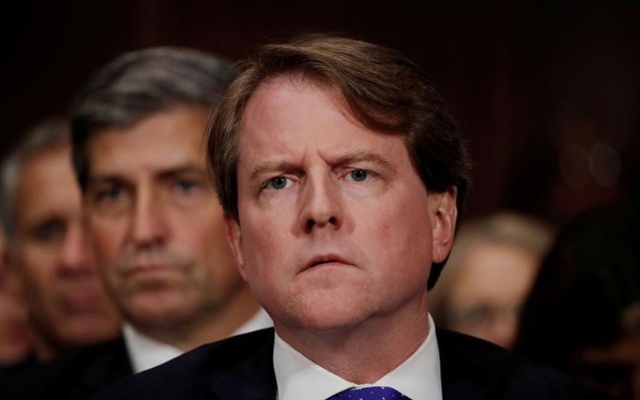 FILE PHOTO: White House counsel Don Mcgahn listens to US Supreme Court nominee Brett Kavanaugh testify before a Senate Judiciary Committee confirmation hearing on Capitol Hill in Washington, US, Sep 27, 2018. REUTERS/Jim Bourg/File Photo