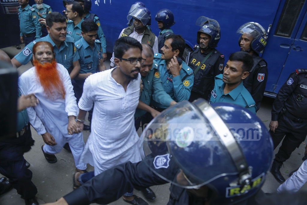 Shariful Islam Khaled alias Khalid and Mizanur Rahman alias Boro Mizan are being taken to court before a Dhaka tribunal announces the verdict on the Holey Artisan attack case. Khalid has been sentenced to death and Mizan acquitted in 2016 horrific attack on the upscale cafe.