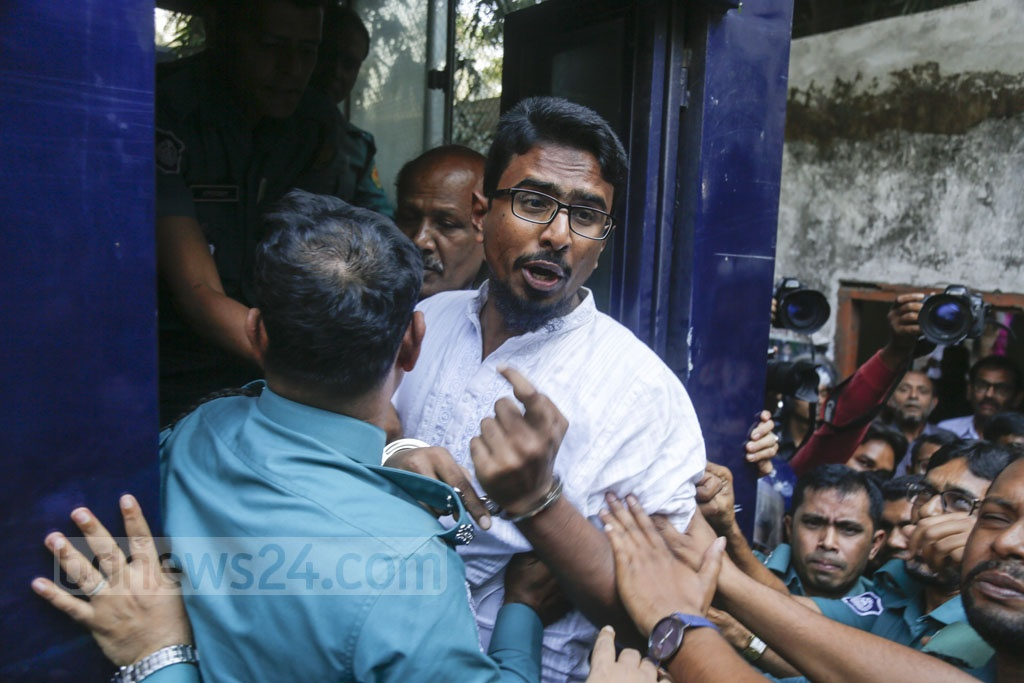 Shariful Islam Khaled alias Khalid, one of the convicts sentenced to death for his role in 2016 Holey Artisan attack, is being taken to the Dhaka Central Jail in Keraniganj from the court.