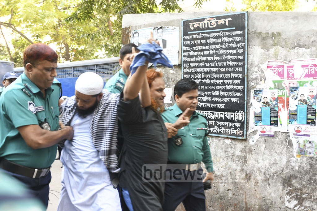 Jahangir Hossain alias Rajib Gandhi and Abdus Sabur Khan are being taken to court before a Dhaka tribunal announces the much-awaited verdict on the Holey Artisan attack case. Both have been sentenced to death for their roles in 2016 horrific attack on the cafe.
