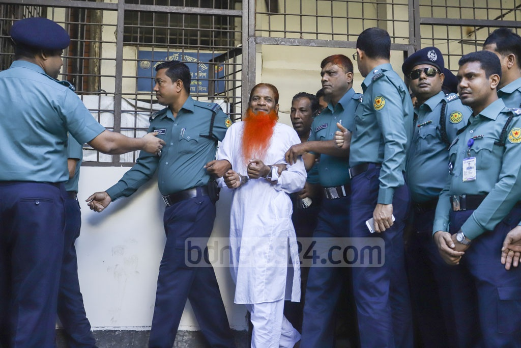 Mizanur Rahman alias Boro Mizan is being taken to court before a Dhaka tribunal announces the much-awaited verdict on the Holey Artisan attack case. He has been acquitted as the charges against him could not be proved.