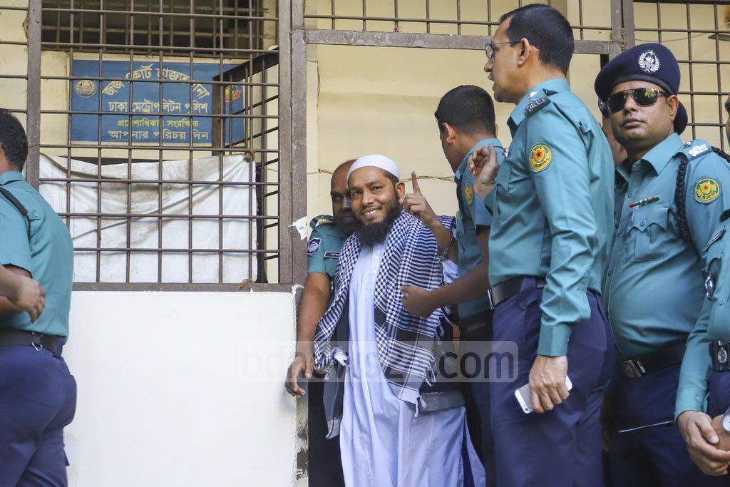 Abdus Sabur Khan smiles as he is being taken to court from jail. He is one of the convicts sentenced to death for his role in 2016 Holey Artisan attack.