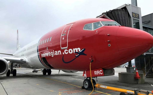FILE PHOTO: A Norwegian Air plane is refuelled at Oslo Gardermoen airport, Norway November 7, 2019. Reuters