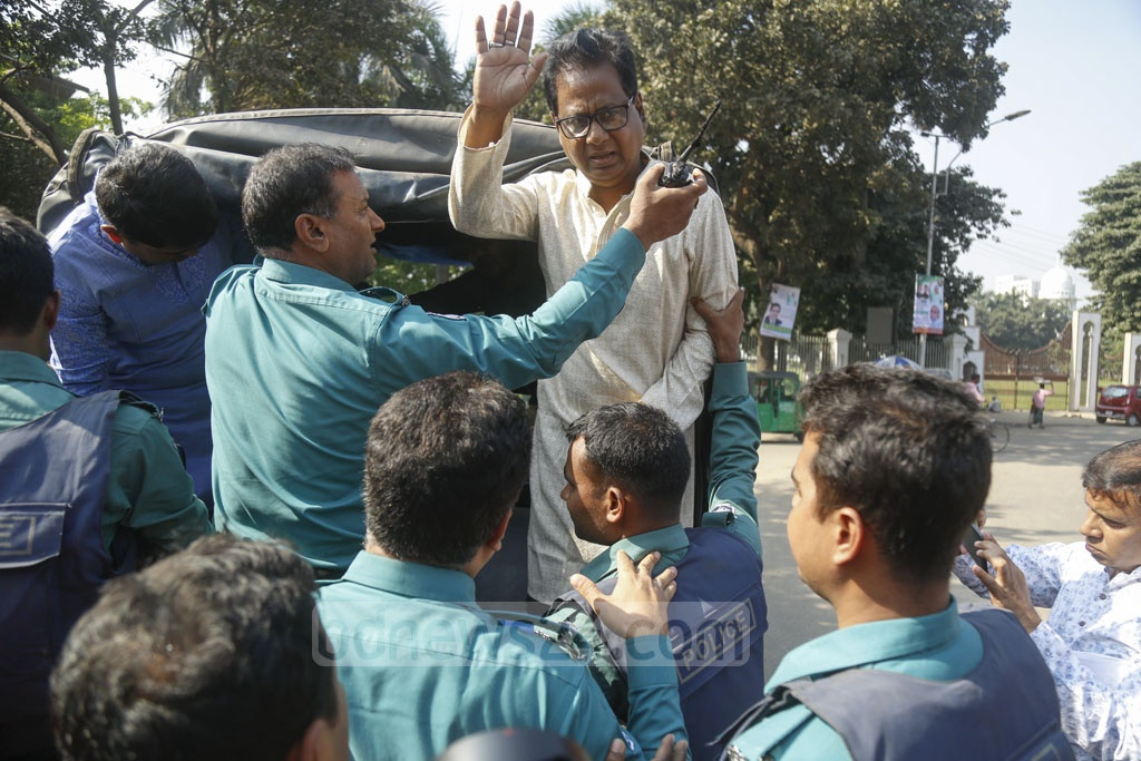 Police detain BNP leader ABM Mosharraf Hossain after an event at the National Press Club in Dhaka on Friday. Photo: Mahmud Zaman Ovi