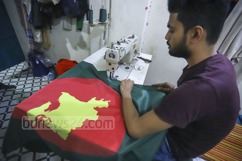 A tailor making a national flag of Bangladesh as the demand for the flag is expected to rise ahead of the Dec 16 Victory Day. Photo: Asif Mahmud Ove