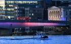 A police boat sails on Thames river as an empty bus stands at London Bridge after an incident, in London, Britain, November 29, 2019. Reuters