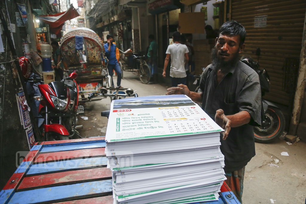 Calendars are being taken for binding in the capital's Fakirapool on Sunday. Photo: Mahmud Zaman Ovi
