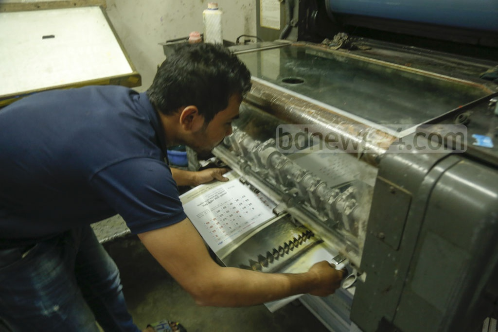 A worker checking printed calendars in the capital's Fakirapool on Sunday. Photo: Mahmud Zaman Ovi