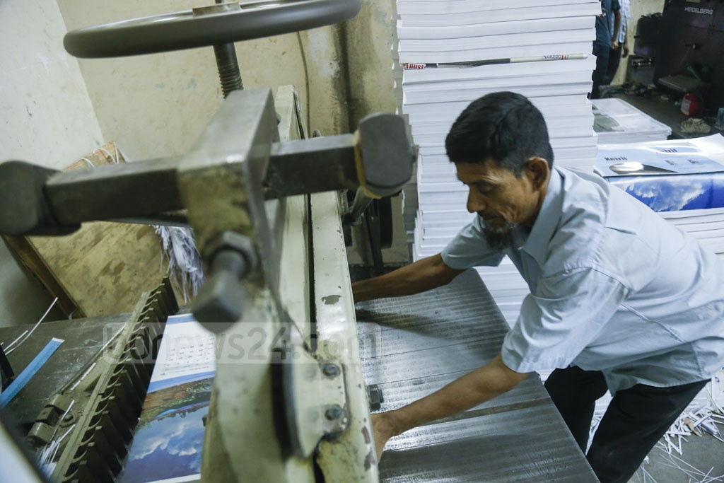 A worker printing calendars in the capital's Fakirapool on Sunday. Photo: Mahmud Zaman Ovi